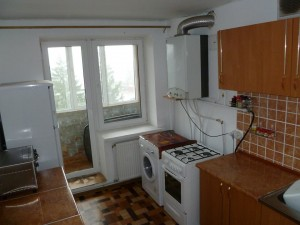 The kitchen with small balcony/pantry